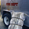 Tribune-Star/Jim Avelis<br /> Ready when needed: A bundle of 1000 sandbags lays in the Prairieton firehouse Monday, ready to be distributed when needed.