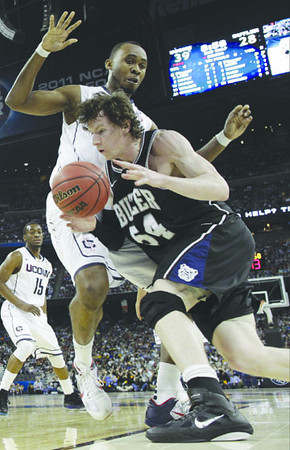 Butler's Matt Howard is defended by Connecticut's Charles Okwandu during the second half of the men's NCAA Final Four college basketball championship game Monday, April 4, 2011, in Houston. (AP Photo/David J. Phillip)