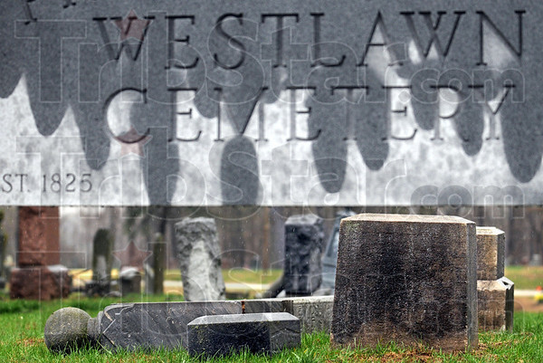 Vandalized: Tombstones lay on the ground after being toppled by vandals last week.