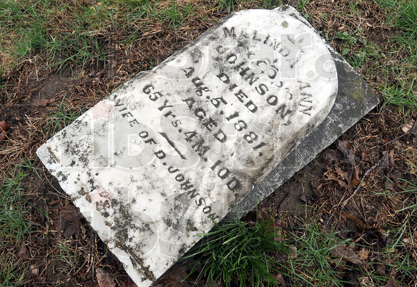 Broken: A tombstone dating back to 1881 was broken by vandals in the Prairie Creek Westlawn Cemetery over the weekend.
