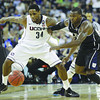 Connecticut's Alex Oriakhi and Butler's Shelvin Mack go after a loose ball cduring the second half of the men's NCAA Final Four college basketball championship game Monday, April 4, 2011, in Houston. (AP Photo/Eric Gay)