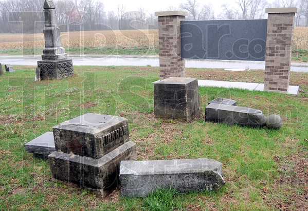 Toppled: Tombstones in the Prairie Creek Westlawn Cemetery were toppled by vandals over the weekend.