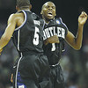 Butler's Shelvin Mack, right, reacts to making a last-second three-point shot against Connecticut with Ronald Nored, ending the first half of the men's NCAA Final Four college basketball championship game Monday, April 4, 2011, in Houston. (AP Photo/David J. Phillip)