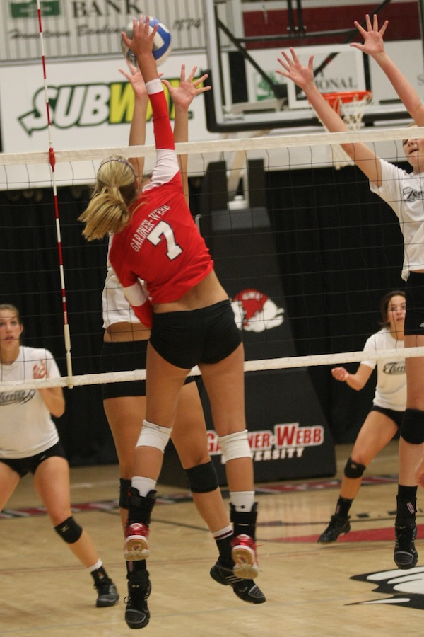 Melissa Richie, number 7, spikes the ball.