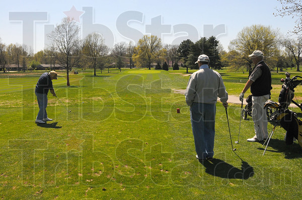 Tribune-Star/Jim Avelis<br /> High impact: Golfers tee of at Rea Park Tuesday afternoon.
