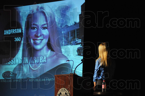 Tribune-Star/Jim Avelis<br /> Recorded for history: Beth Holloway, lower right, watches her video compilation of news braodcasts and talk show appearances from about the time her daughter Natalie went missing in Aruba.