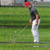 Tribune-Star/Jim Avelis<br /> New lie: Thomas Goss scoops his ball from standing water during the county golf meet Tuesday at Rea Park.