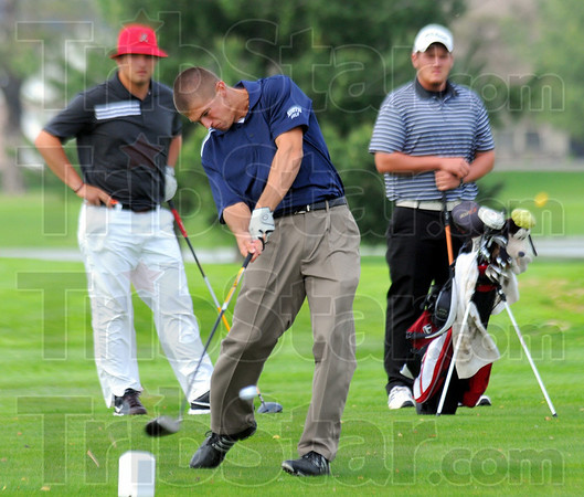 Tribune-Star/Jim Avelis<br /> First three: The number one golfers for the three county schools are Thomas Goss, Ryan Sneddon and Brandon Blystone. Here Sneddon tees off on Rea Parks'#2 tee.