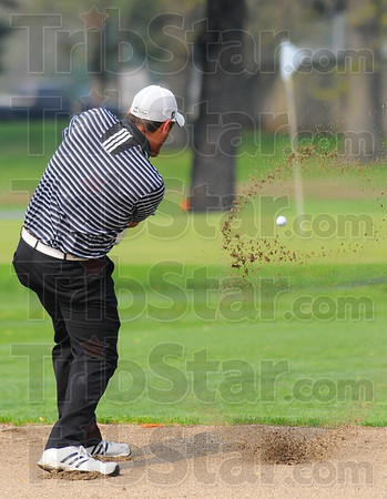 Tribune-Star/Jim Avelis<br /> Trapped: Brandon Blystone hits from a sand trap on #2 at Rea Park during the county golf meet.