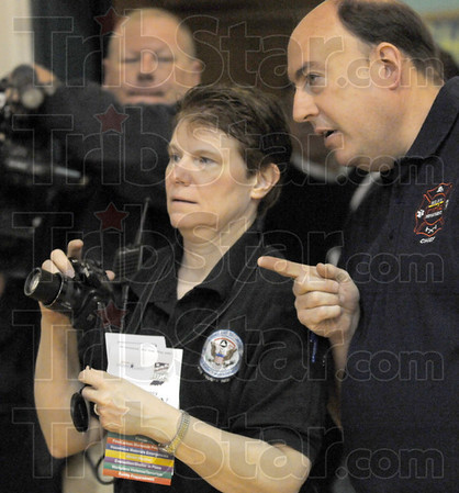 Picture this: EMA Chief Dr. Dorene Hojnicki and Vigo County Sheriff's deputy Jeff Fox confer during Tuesday's earthquake simulation event at Riley Elementary School.