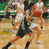 To the hoop:Alicyn Woodward(24) drives to the paint in West Vigo's game with Greencastle Thursday evening.