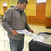 Tribune-Star/Jim Avelis<br /> For the record: Paul Finkbiner slides his completed ballot into the counter at St. Marys' Catholic Church in Marshall .