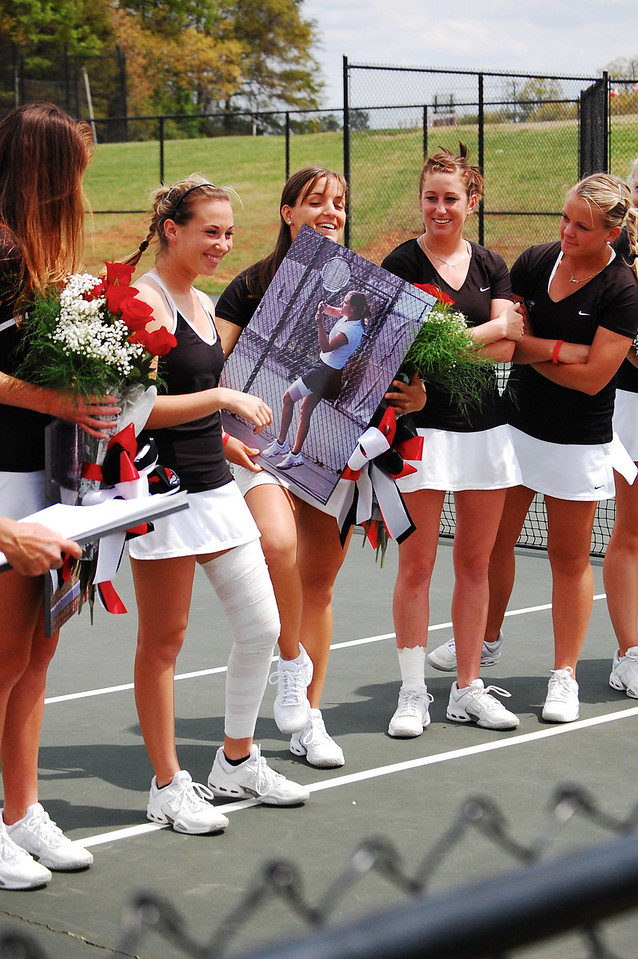 Seniors are recognized by receiving flowers and a portrait of themselves.