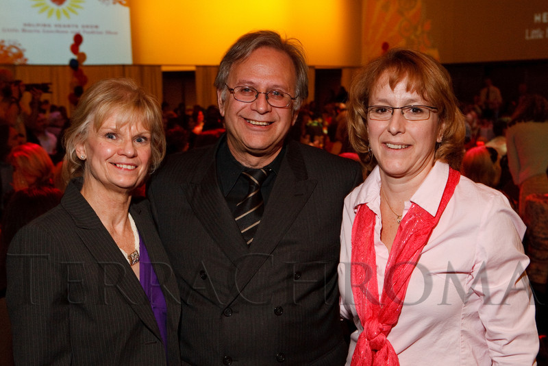 (Denver, Colorado, April 8, 2011)<br /> Lyn and Dr. Michael Schaffer with Lori Claussen, the Heart Who Cares Award recipient.  The 2011 Little Hearts Luncheon and Fashion Show, benefiting The Children's Hospital Heart Institute, at the Infinity Park Event Center in Denver, Colorado, on Friday, April 8, 2011.<br /> STEVE PETERSON