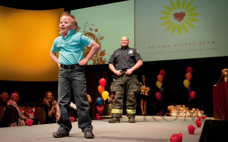 (Denver, Colorado, April 8, 2011)<br /> Kennedy Lewis and firefighter Mike DeBoer.  The 2011 Little Hearts Luncheon and Fashion Show, benefiting The Children's Hospital Heart Institute, at the Infinity Park Event Center in Denver, Colorado, on Friday, April 8, 2011.<br /> STEVE PETERSON
