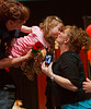(Denver, Colorado, April 8, 2011)<br /> Firefighter Kara Phillips helps Lilly Zareck get a kiss from family friend Lisa Pankonin.  The 2011 Little Hearts Luncheon and Fashion Show, benefiting The Children's Hospital Heart Institute, at the Infinity Park Event Center in Denver, Colorado, on Friday, April 8, 2011.<br /> STEVE PETERSON