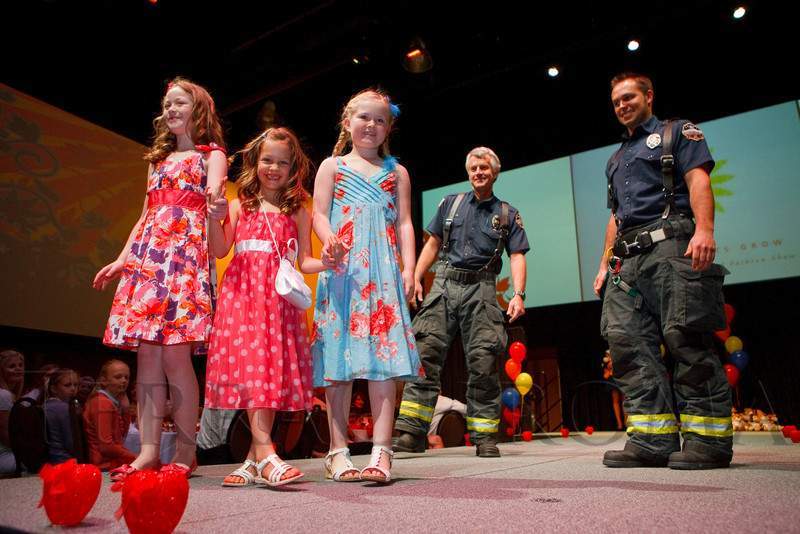 (Denver, Colorado, April 8, 2011)<br /> Emily Fairbairn, Brooke Ballenger, and Sydney Fairbairn, escorted by firefighters, Dan Ribis and Matt Bovee.  The 2011 Little Hearts Luncheon and Fashion Show, benefiting The Children's Hospital Heart Institute, at the Infinity Park Event Center in Denver, Colorado, on Friday, April 8, 2011.<br /> STEVE PETERSON