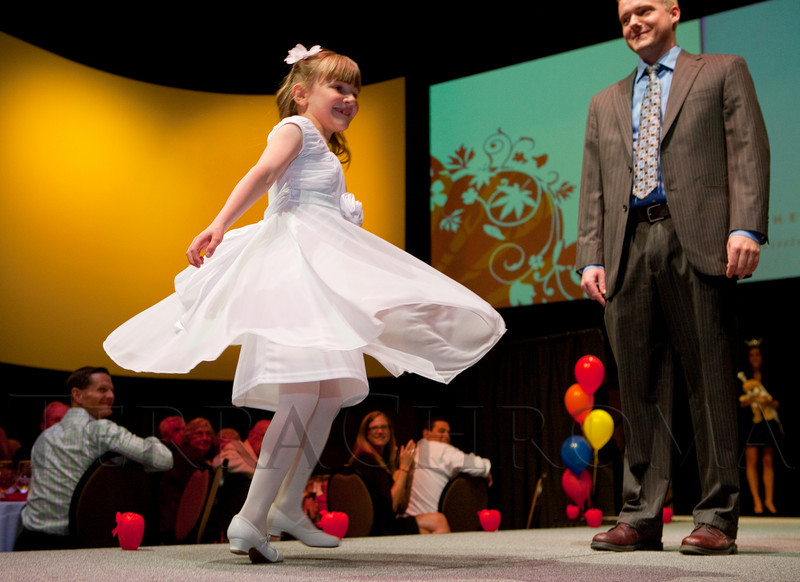 (Denver, Colorado, April 8, 2011)<br /> Caylee Springer and Dr. Jeff Darst.  The 2011 Little Hearts Luncheon and Fashion Show, benefiting The Children's Hospital Heart Institute, at the Infinity Park Event Center in Denver, Colorado, on Friday, April 8, 2011.<br /> STEVE PETERSON