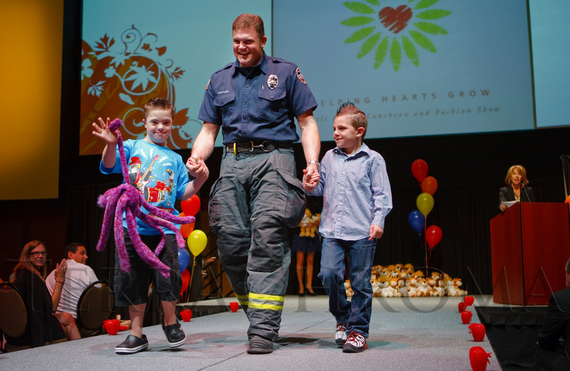 (Denver, Colorado, April 8, 2011)<br /> Brenden Scialla, firefighter Chad Loeks, and Landon Scialla.  The 2011 Little Hearts Luncheon and Fashion Show, benefiting The Children's Hospital Heart Institute, at the Infinity Park Event Center in Denver, Colorado, on Friday, April 8, 2011.<br /> STEVE PETERSON
