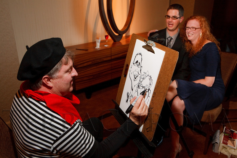 """(Denver, Colorado, April 16, 2011)<br /> Jake Williams draws caricature of Martin Rowe and Dr. Kristen Park.  """"la vie en Rose,"""" a benefit for the Epilepsy Foundation of Colorado and the Jason Fleishman Summer Camp, at the Four Seasons Hotel Denver in Denver, Colorado, on Saturday, April 16, 2011.<br /> STEVE PETERSON"""