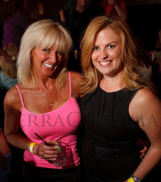 (Denver, Colorado, April 22, 2011)<br /> Lisa Brown and Joanne Thompson, guests who won tickets to the event by a radio prize.  The 7th Annual Colorado Firefighter Celebrity Judging Event at Exdo Event Center in Denver, Colorado, on Friday, April 22, 2011.<br /> STEVE PETERSON