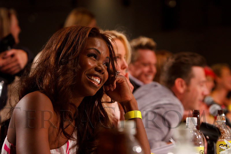 (Denver, Colorado, April 22, 2011)<br /> Judge Erica Cobb reacts to a suggestive question by Chris Parente (leaning forward).  The 7th Annual Colorado Firefighter Celebrity Judging Event at Exdo Event Center in Denver, Colorado, on Friday, April 22, 2011.<br /> STEVE PETERSON