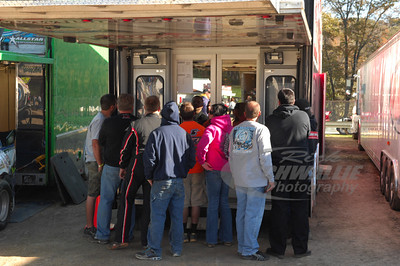 Fans and Drivers watching the timing and scoring at the back of the LOLMDS Trailer