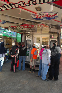 Fans and Drivers watch timing and scoring at the back of the LOLMDS Trailer