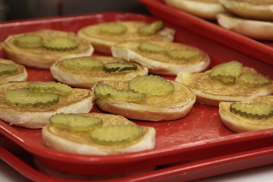 During Chick-fil-a's one year anniversary celebration, buns prepared with pickle slices await pieces of chicken to join them and create Chick-fil-a's famous signature sandwich to give away to students at Gardner-Webb University.