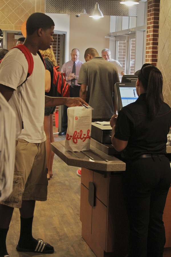 Student takes advantage of Chick-fil-a's Anniversary special of getting one free chicken sandwich or  box of chicken nuggets between 12-1pm.