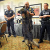 Dog days: Terre Haute Chief of Police John Plasse (L) cracks a smile as Sgt. Terry John gets some attention from his K-9 partner during a meeting with the Breakfast Optimist. At right is officer Adam Lowdermilk.