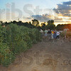 Tribune-Star/Jim Avelis<br /> Foot tour: Gardeners walk through the Giving Garden at the Wabash Valley Fairgrounds Thursday evening. The Twilight Tour is part of the Wabash Valley Master gardener program.