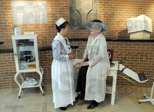 Period costumes: Peggy Apgar and Mary Lee Hagan are dressed in period costumes during Thursday's Founder's Day program at Union Hospital.