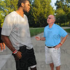 Tribune-Star/Jim Avelis<br /> Time to talk: Greg Oden chats with Jerry Dooley at the fundraiser barbecue for the Terre Haute Boy's and Girl's Club Thursday evening. Today's benefit golf outing is named for Dooley's grandson Travis Smith, former classmate of Oden's.