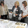 Photos: Union Hospital employees Kathy Pallutch, Pam Alexander and Jo Bormann enjoy looking at old photographs during Founder's Day activites Thursday afternoon.