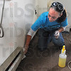 Tribune-Star/Rachel Keyes<br /> Helping hand: Lynsee Smith cleans an apartment at Deming Center as part of Community Care Day.
