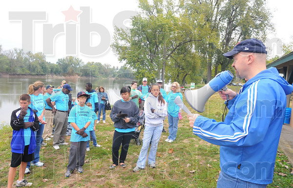 Tribune-Star/Rachel Keyes<br /> Rally the troops: Pastor Paul Wagner of Centenary United Methodist Church (right) organizes his parishioners into teams before sending them out into the community for Community Care Day.
