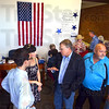 Schmoozing: Democrat faithful gather and gab during Thursday's opening of the Democrat Headquarters located at 509 Wabash.