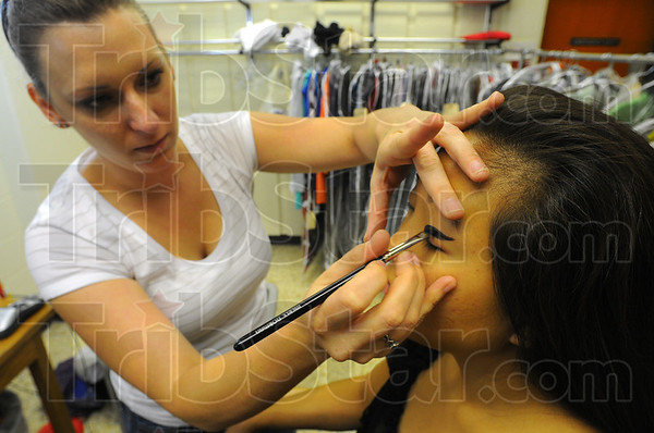 "Tribune-Star/Jim Avelis<br /> Making up: Jillian Erickson applies makeup to the eyes of actress Deanna Myers for the afternoon filming of a scene of ""The Drunk""."