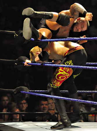 Tribune-Star/Rachel Keyes<br /> Get off my back: Randy Orton rolls off the back of Christian at Smackdown on Sunday night at Hulman Center.