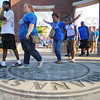 Tribune-Star/Rachel Keyes<br /> Right of passage: Indiana State incoming freshmen walk across the school seal at 3rd and Cherry as the become official students at Indiana State.