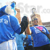Tribune-Star/Rachel Keyes<br /> Sam says hi: Sycamore Sam greets incoming freshman Imani Mayo after walking across the Indiana State Seal.