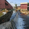 Dam water: Water flows over the dam in Bridgeton with the Bridgeton Mill at top right Thursday afternoon.