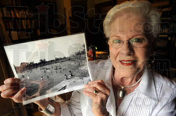 1936 Photo: Mary Lee Hagan holds a photograph of the Fairbanks Park swimming pool dated 1936. The pool was removed in 1966.