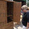 Tribune-Star/Rachel Keyes<br /> Searching for treasure: Joan Foradori-Cook searches through the big ticket items a the Habitat for Humanity ReStore Saturday morning.