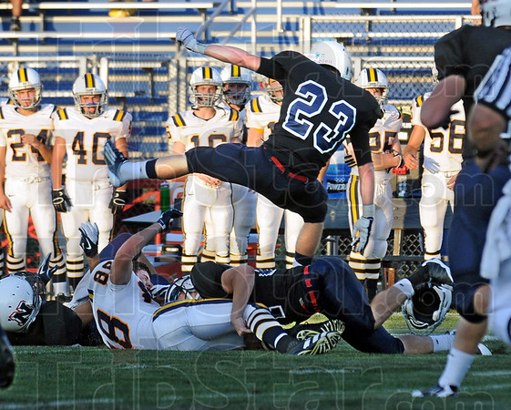 Leaping: North safety Austin Lewis leaps to avoid landing on the tackler and runner during game action Friday night.