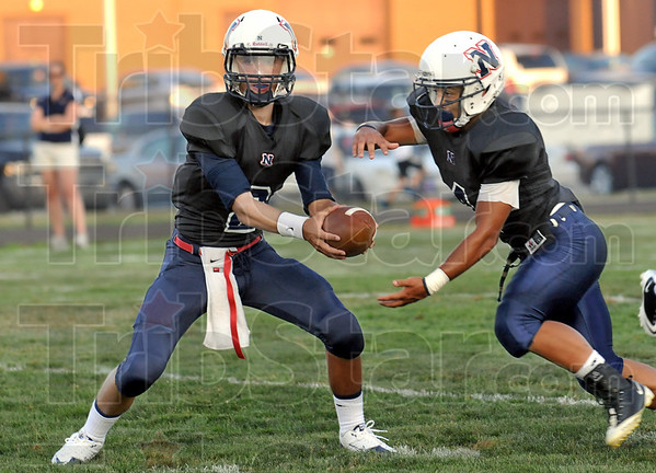 Hand-off: North quarterback #2, Chris Barrett Jr. hands the ball to #4, Brother Skank during first half play against Castle Friday night.