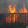 Flames: Flames leap from the burned shell of an abandoned mobile home in Fontanet, Indiana Friday afternoon.