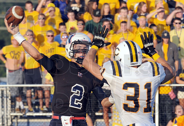 Pressured: North quarterback Chris Barrett Jr. gets pressured by Castle defender #31, Jace-Talbert Bartley during first quarter action Friday night.