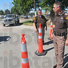 Police presence: Sheriff's Lt's Steve Barnhart and Tim Osborn work the scheid diesel event Friday afternoon.